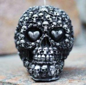 Skulls on skulls black paraffin candle